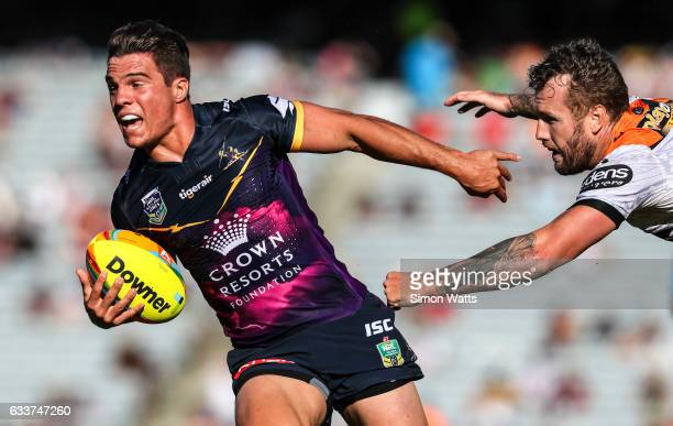 Brodie Croft of the Storm beats the tackle of Jordan Rankin of the Tigers during the 2017 Auckland Nines match between the Wests Tigers and the...