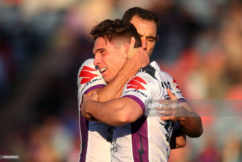 Brodie Croft of the Storm celebrates a try with team mate Cameron Smith during the round 24 NRL match between the Newcastle Knights and the Melbourne Storm at McDonald Jones Stadium on August 19, 2017 in Newcastle, Australia.
