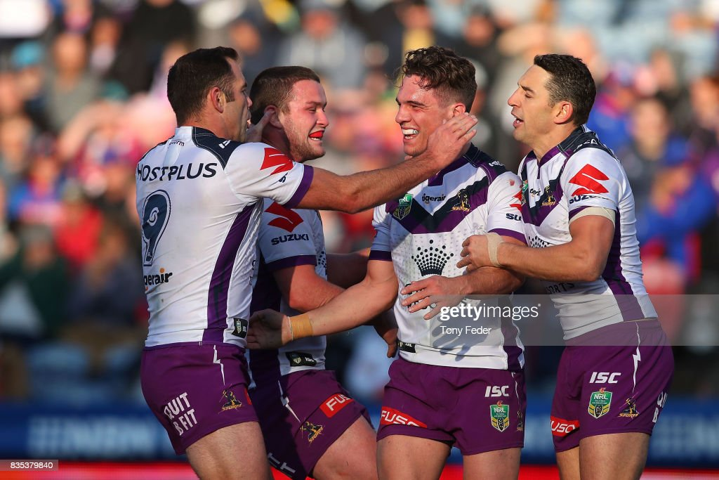 Brodie Croft of the Storm celebrates a try with team mates during the round 24 NRL match between the Newcastle Knights and the Melbourne Storm at McDonald Jones Stadium on August 19, 2017 in Newcastle, Australia.