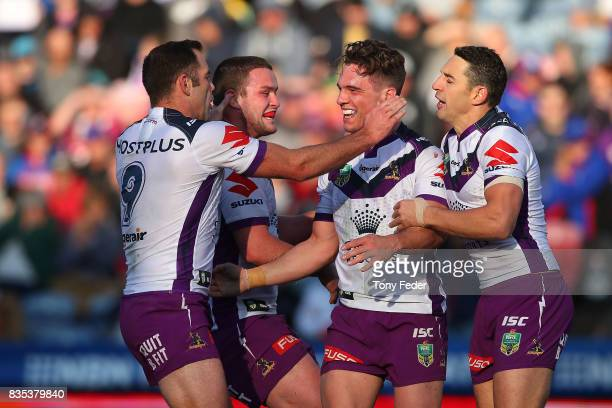Brodie Croft of the Storm celebrates a try with team mates during the round 24 NRL match between the Newcastle Knights and the Melbourne Storm at...