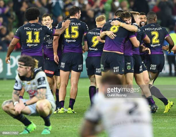 Brodie Croft of the Storm is congratulated by team mates after kicking the winning field goal during the round 15 NRL match between the Melbourne...