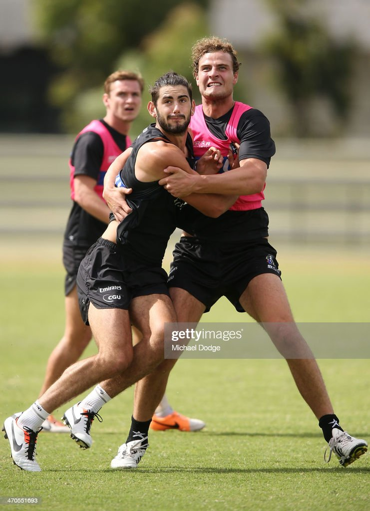 Brodie Grundy (L) and Jarrod Witts contest for the ball in the ruck during a Collingwood Magpies AFL training session at Olympic Park on February 20, 2014 in Melbourne, Australia.