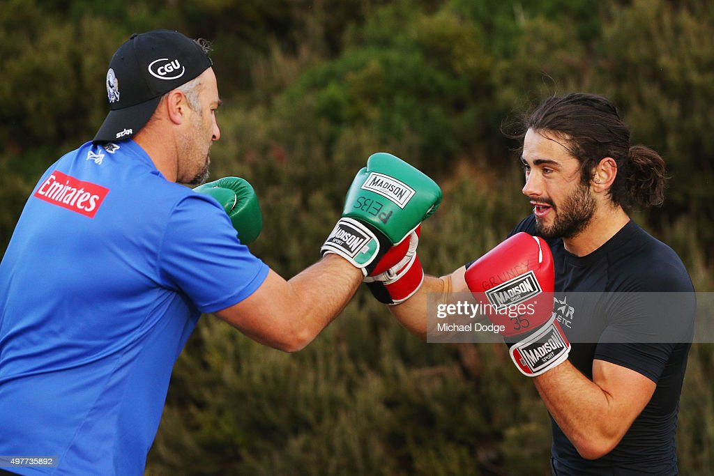 Brodie Grundy (R) boxes with the assistant coach Anthony Rocca in the circuit session during a Collingwood Magpies AFL pre-season training camp at Falls Creek on November 19, 2015 in Falls Creek, Australia.