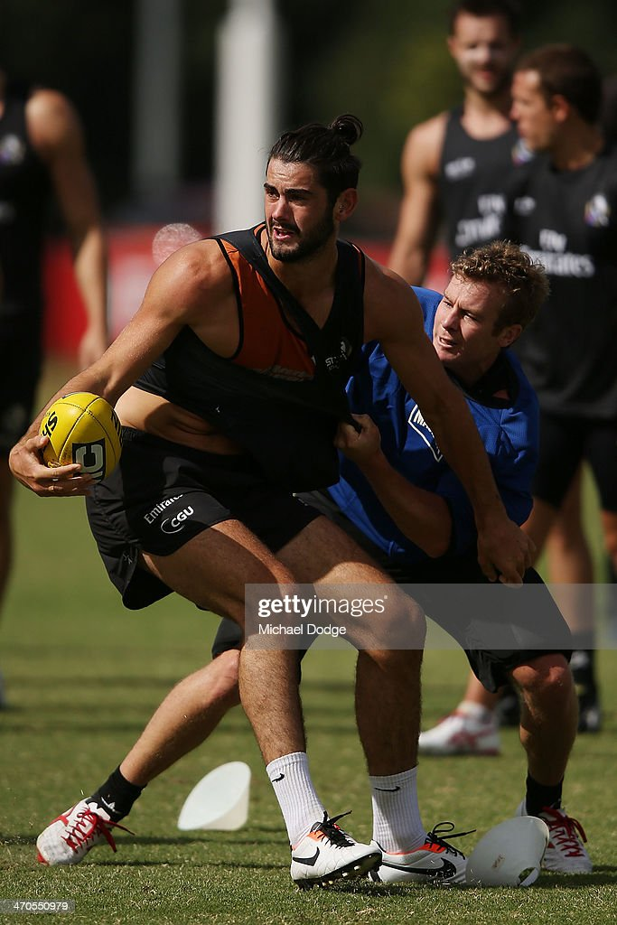 Brodie Grundy is tackled during a Collingwood Magpies AFL training session at Olympic Park on February 20, 2014 in Melbourne, Australia.