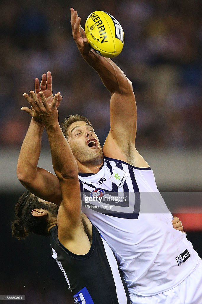Brodie Grundy (L) of the Magpies and Aaron Sandilands of the Dockers contest for the ball during the round one AFL match between the Collingwood Magpies and the Fremantle Dockers at Etihad Stadium on March 14, 2014 in Melbourne, Australia.