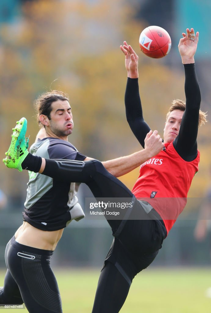 Brodie Grundy of the Magpies (L) and Darcy Moore compete for the ball during a Collingwood Magpies AFL training session at Gosch's Paddock on June 19, 2017 in Melbourne, Australia.