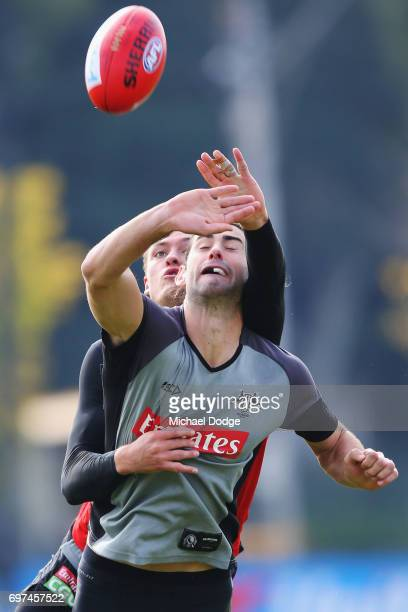 Brodie Grundy of the Magpies and Darcy Moore compete for the ball during a Collingwood Magpies AFL training session at Gosch's Paddock on June 19...