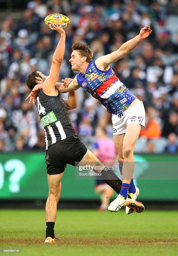 Brodie Grundy of the Magpies and Jordan Roughead of the Bulldogs compete for the ball during the round 10 AFL match between the Collingwood Magpies and the Western Bulldogs at Melbourne Cricket Ground on May 29, 2016 in Melbourne, Australia.