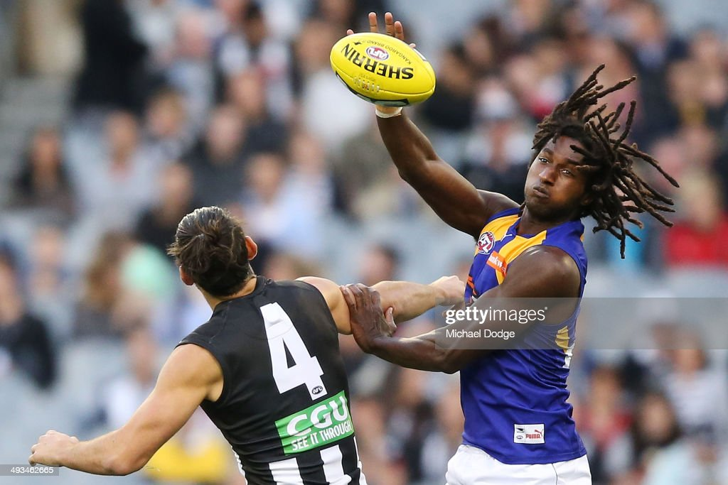 Brodie Grundy (L) of the Magpies and Nic Naitanui of the Eagles compete for the ball during the round 10 AFL match between the Collingwood Magpies and West Coast Eagles at Melbourne Cricket Ground on May 24, 2014 in Melbourne, Australia.