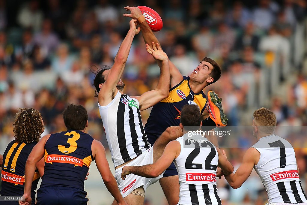 Brodie Grundy of the Magpies and Scott Lycett of the Eagles contest the ruck during the round six AFL match between the West Coast Eagles and the Collingwood Magpies at Domain Stadium on May 1, 2016 in Perth, Australia.