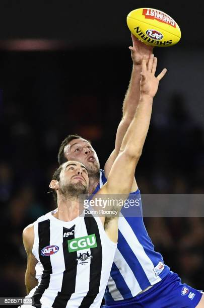 Brodie Grundy of the Magpies and Todd Goldstein of the Kangaroos compete in the ruck during the round 20 AFL match between the North Melbourne...