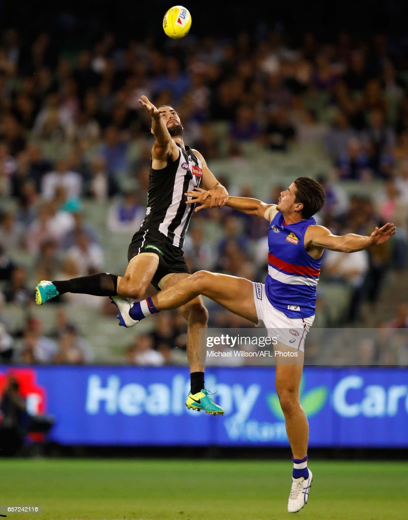 Brodie Grundy of the Magpies and Tom Boyd of the Bulldogs compete in a ruck contest during the 2017 AFL round 01 match between the Collingwood Magpies and the Western Bulldogs at the Melbourne Cricket Ground on March 24, 2017 in Melbourne, Australia.