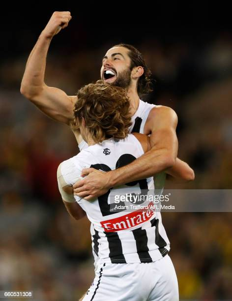 Brodie Grundy of the Magpies celebrates a goal with Tim Broomhead of the Magpies during the 2017 AFL round 02 match between the Richmond Tigers and...