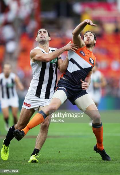 Brodie Grundy of the Magpies competes for the ball against Shane Mumford of the Giants during the round eight AFL match between the Greater Western...