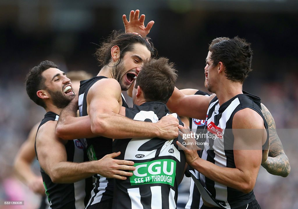 Brodie Grundy of the Magpies is congratulated by team mates after kicking a goal during the round nine AFL match between the Collingwood Magpies and...