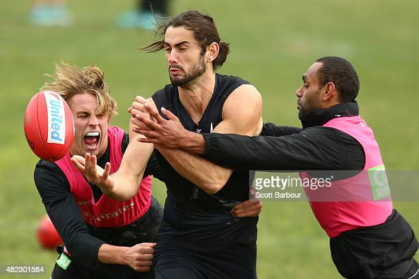 Brodie Grundy of the Magpies is tackled by Travis Varcoe during a Collingwood Magpies Training Session at Olympic Park on July 30 2015 in Melbourne...
