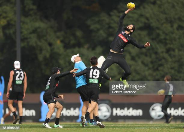 Brodie Grundy of the Magpies leaps for the ball during a Collingwood Magpies AFL training session at Olympic Park on May 11 2017 in Melbourne...