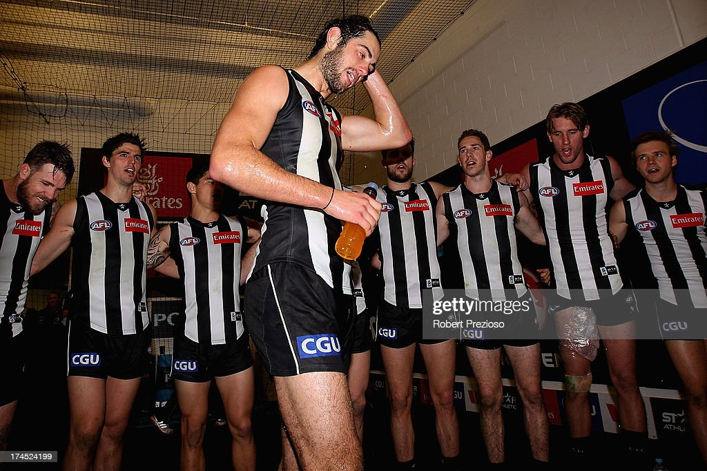 Brodie Grundy of the Magpies sings the club song after a win during the round 18 AFL match between the Collingwood Magpies and the Greater Western Sydney Giants at Melbourne Cricket Ground on July 27, 2013 in Melbourne, Australia.