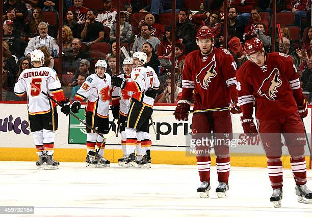 Brodie Mark Giordano Johnny Gaudreau and Jiri Hudler of the Calgary Flames celebrate a second period goal as Martin Hanzal and teammate Michael Stone...