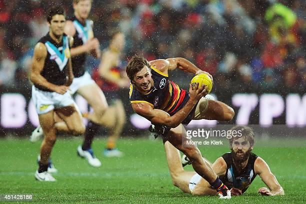 Brodie Martin of the Crows runs with the ball during the round 15 AFL match between the Adelaide Crows and the Port Adelaide Power at Adelaide Oval...