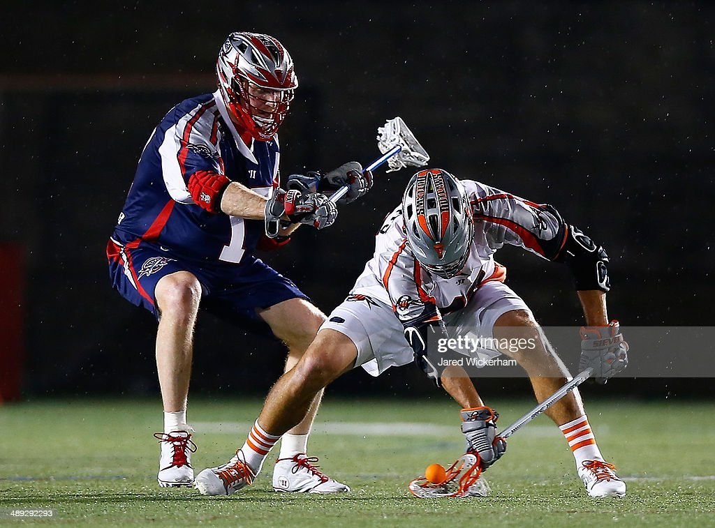 <a gi-track='captionPersonalityLinkClicked' href=/galleries/search?phrase=Brodie+Merrill&family=editorial&specificpeople=5984414 ng-click='$event.stopPropagation()'>Brodie Merrill</a> #17 of the Boston Cannons and Jeremy Sieverts #20 of the Denver Outlaws fight for the ball in the second half at Harvard Stadium on May 10, 2014 in Boston, Massachusetts.