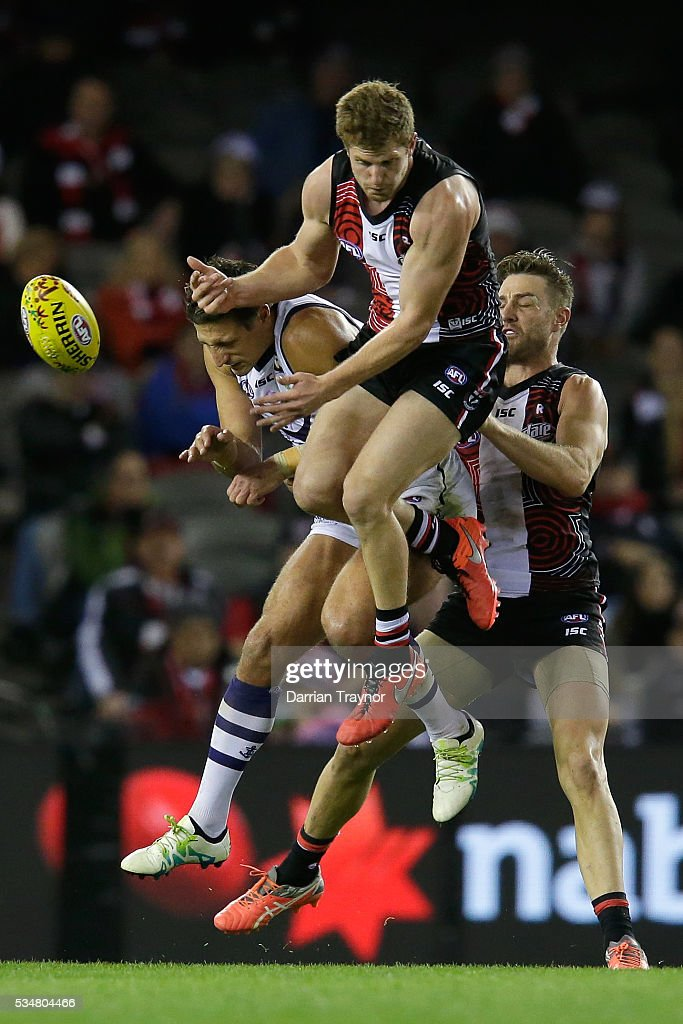 Brodie Murdoch of the Saints crashes into <a gi-track='captionPersonalityLinkClicked' href=/galleries/search?phrase=Matthew+Pavlich&family=editorial&specificpeople=208649 ng-click='$event.stopPropagation()'>Matthew Pavlich</a> of the Dockers during the round 10 AFL match between the St Kilda Saints and the Fremantle Dockers at Etihad Stadium on May 28, 2016 in Melbourne, Australia.