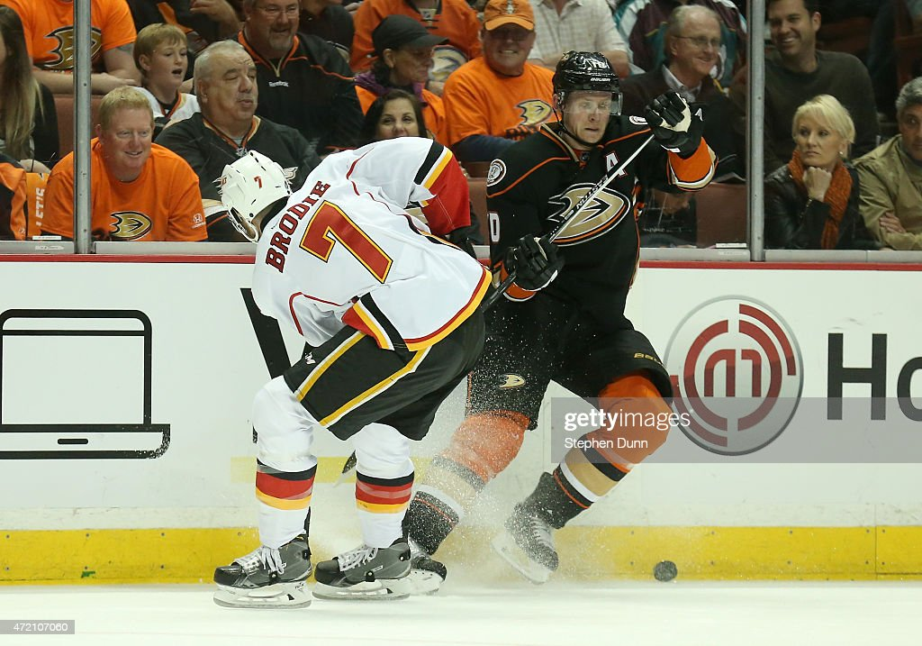 TJ Brodie #7 of the Calgary Flames and Corey Perry #10 of the Anaheim Ducks battle along the boards in Game Two of the Western Conference Semifinals during the 2015 NHL Stanley Cup Playoffs at Honda Center on May 3, 2015 in Anaheim, California.