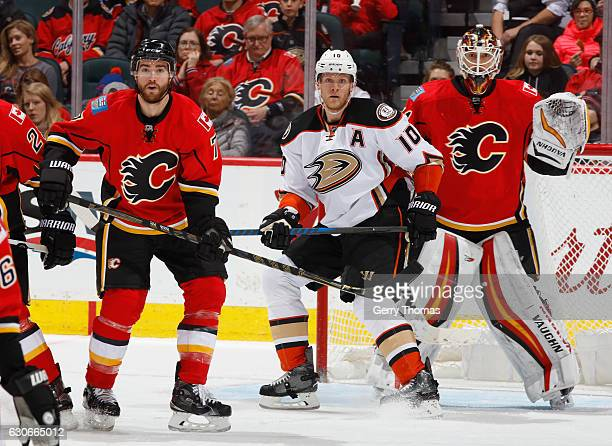 Brodie of the Calgary Flames battles against Corey Perry of the Anaheim Ducks at Scotiabank Saddledome on December 29 2016 in Calgary Alberta Canada