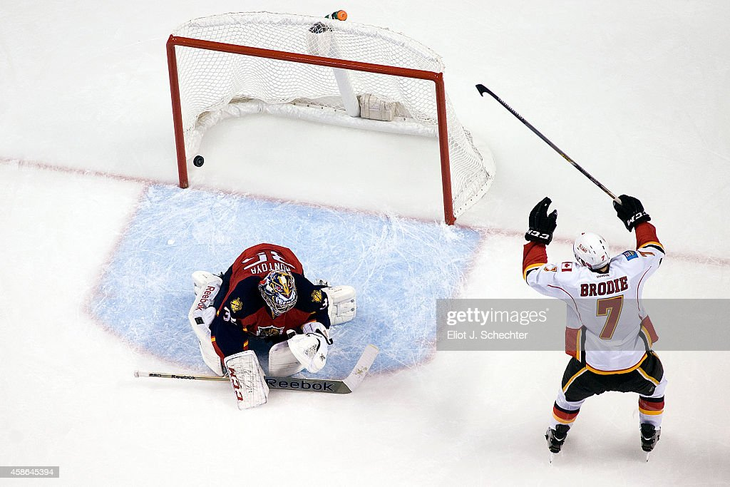 T.J. Brodie #17 of the Calgary Flames celebrates a goal by teammate Sean Monahan #23 (not pictured) against Goaltender Al Montoya #35 of the Florida Panthers at the BB&T Center on November 8, 2014 in Sunrise, Florida.
