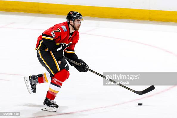 Brodie of the Calgary Flames plays the puck up the ice during third period action against the Winnipeg Jets at the MTS Centre on January 9 2017 in...