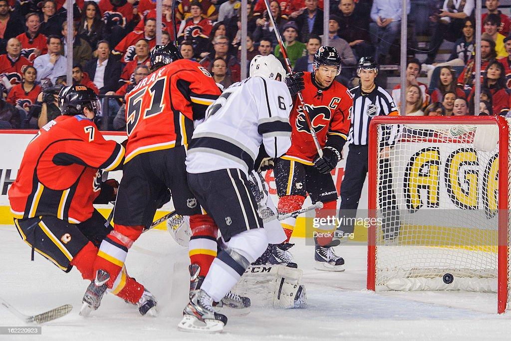 T.J. Brodie #7 of the Calgary Flames scores on Jonathan Bernier #45 of the Los Angeles Kings during an NHL game at Scotiabank Saddledome on February 20, 2013 in Calgary, Alberta, Canada.