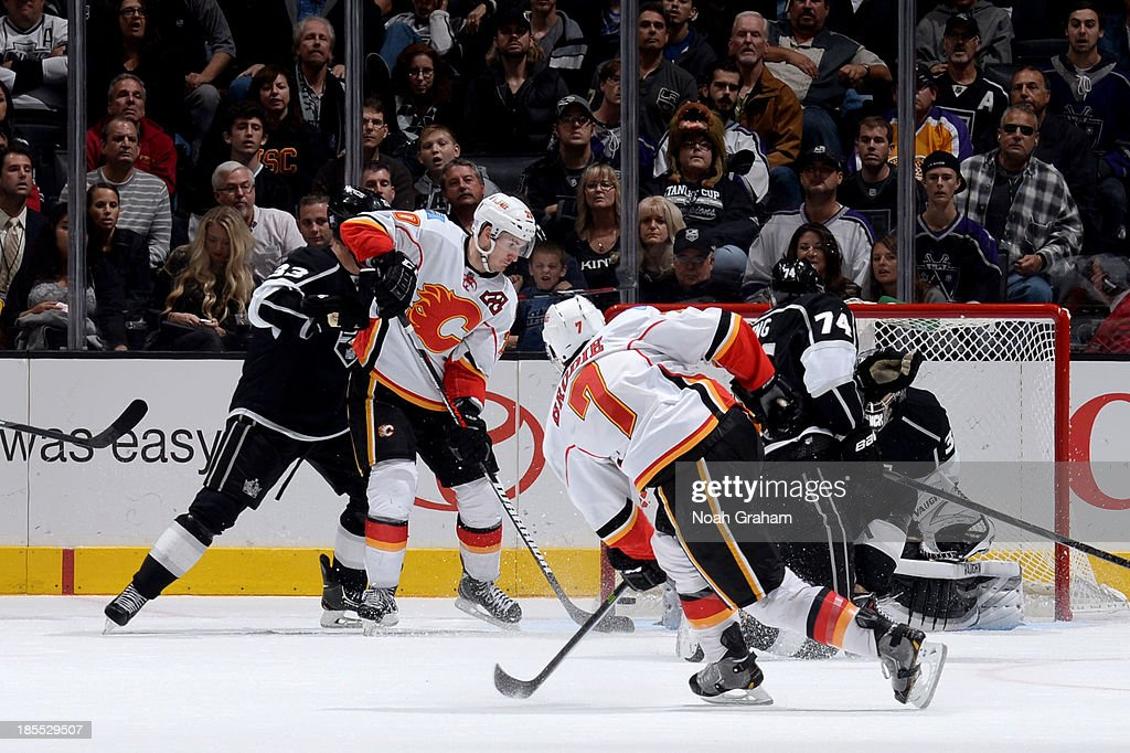 <a gi-track='captionPersonalityLinkClicked' href=/galleries/search?phrase=TJ+Brodie&family=editorial&specificpeople=7220398 ng-click='$event.stopPropagation()'>TJ Brodie</a> #7 of the Calgary Flames shoots and scores the game winning goal against the Los Angeles Kings at Staples Center on October 21, 2013 in Los Angeles, California.