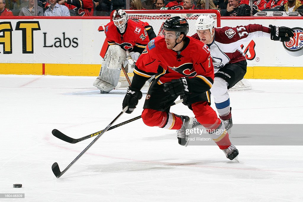 TJ Brodie #7 of the Calgary Flames skates against <a gi-track='captionPersonalityLinkClicked' href=/galleries/search?phrase=Cody+McLeod&family=editorial&specificpeople=2242985 ng-click='$event.stopPropagation()'>Cody McLeod</a> #55 of the Colorado Avalanche on January 31, 2013 at the Scotiabank Saddledome in Calgary, Alberta, Canada.