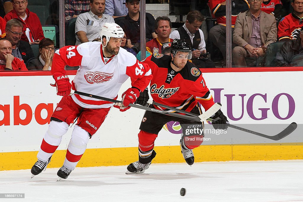 <a gi-track='captionPersonalityLinkClicked' href=/galleries/search?phrase=TJ+Brodie&family=editorial&specificpeople=7220398 ng-click='$event.stopPropagation()'>TJ Brodie</a> #7 of the Calgary Flames skates against <a gi-track='captionPersonalityLinkClicked' href=/galleries/search?phrase=Todd+Bertuzzi&family=editorial&specificpeople=202476 ng-click='$event.stopPropagation()'>Todd Bertuzzi</a> #44 of the Detroit Red Wings at Scotiabank Saddledome on November 1, 2013 in Calgary, Alberta, Canada.
