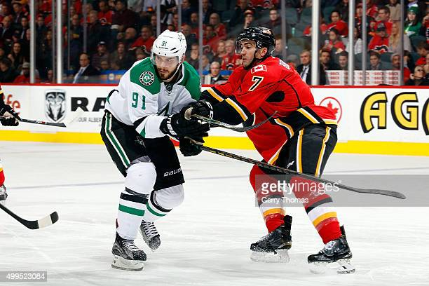 Brodie of the Calgary Flames skates against Tyler Seguin of the Dallas Stars during an NHL game at Scotiabank Saddledome on December 1 2015 in...