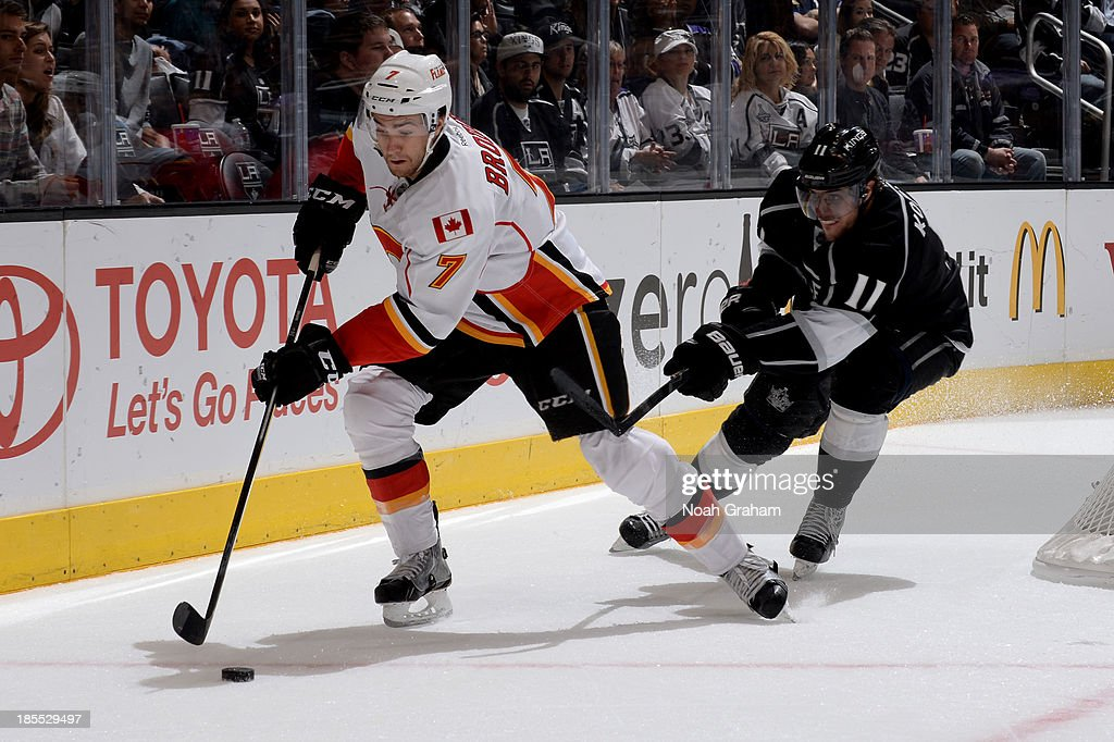 <a gi-track='captionPersonalityLinkClicked' href=/galleries/search?phrase=TJ+Brodie&family=editorial&specificpeople=7220398 ng-click='$event.stopPropagation()'>TJ Brodie</a> #7 of the Calgary Flames skates with the puck against <a gi-track='captionPersonalityLinkClicked' href=/galleries/search?phrase=Anze+Kopitar&family=editorial&specificpeople=634911 ng-click='$event.stopPropagation()'>Anze Kopitar</a> #11 of the Los Angeles Kings at Staples Center on October 21, 2013 in Los Angeles, California.