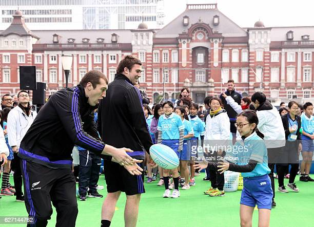 Brodie Retallick and Liam Squire of All Blacks attend a session with children in front of Tokyo Station on December 1 2016 in Tokyo Japan