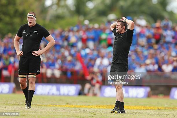 Brodie Retallick and Richie McCaw of the New Zealand All Blacks look on during the International Test match between Samoa and the New Zealand All...