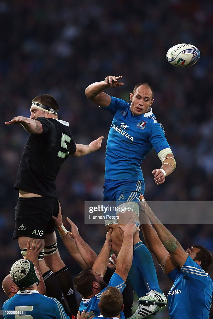 <a gi-track='captionPersonalityLinkClicked' href=/galleries/search?phrase=Brodie+Retallick&family=editorial&specificpeople=7864021 ng-click='$event.stopPropagation()'>Brodie Retallick</a> competes with Sergio Parisee of Italy during the international rugby match between Italy and New Zealand at Stadio Olimpico on November 17, 2012 in Rome, Italy.