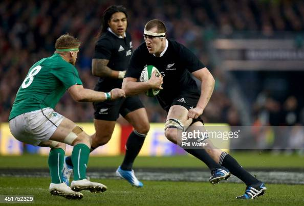 Brodie Retallick of the All Blacks charges at Jamie Heaslip of Ireland during the International match between Ireland and the New Zealand All Blacks...