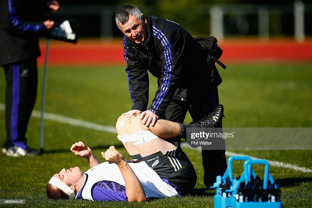 Brodie Retallick of the All Blacks is helped by Manual Therapist George Duncan during a New Zealand All Blacks training session at Trusts Stadium on August 11, 2015 in Auckland, New Zealand.