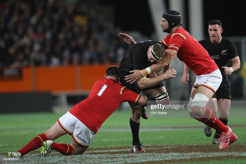 <a gi-track='captionPersonalityLinkClicked' href=/galleries/search?phrase=Brodie+Retallick&family=editorial&specificpeople=7864021 ng-click='$event.stopPropagation()'>Brodie Retallick</a> of the All Blacks is tackled by Rob Evans of Wales during the International Test match between the New Zealand All Blacks and Wales at Forsyth Barr Stadium on June 25, 2016 in Dunedin, New Zealand.
