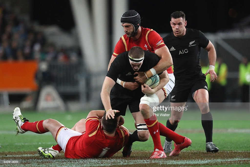 Brodie Retallick of the All Blacks is tackled during the International Test match between the New Zealand All Blacks and Wales at Forsyth Barr Stadium on June 25, 2016 in Dunedin, New Zealand.