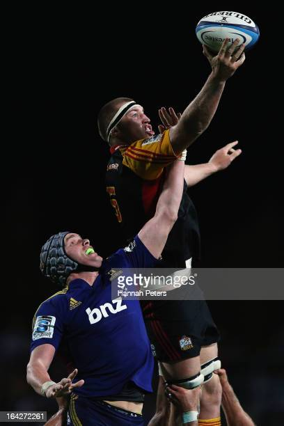 Brodie Retallick of the Chiefs competes with John Hardie of the Highlanders in the lineout during the round six Super Rugby match between the Chiefs...