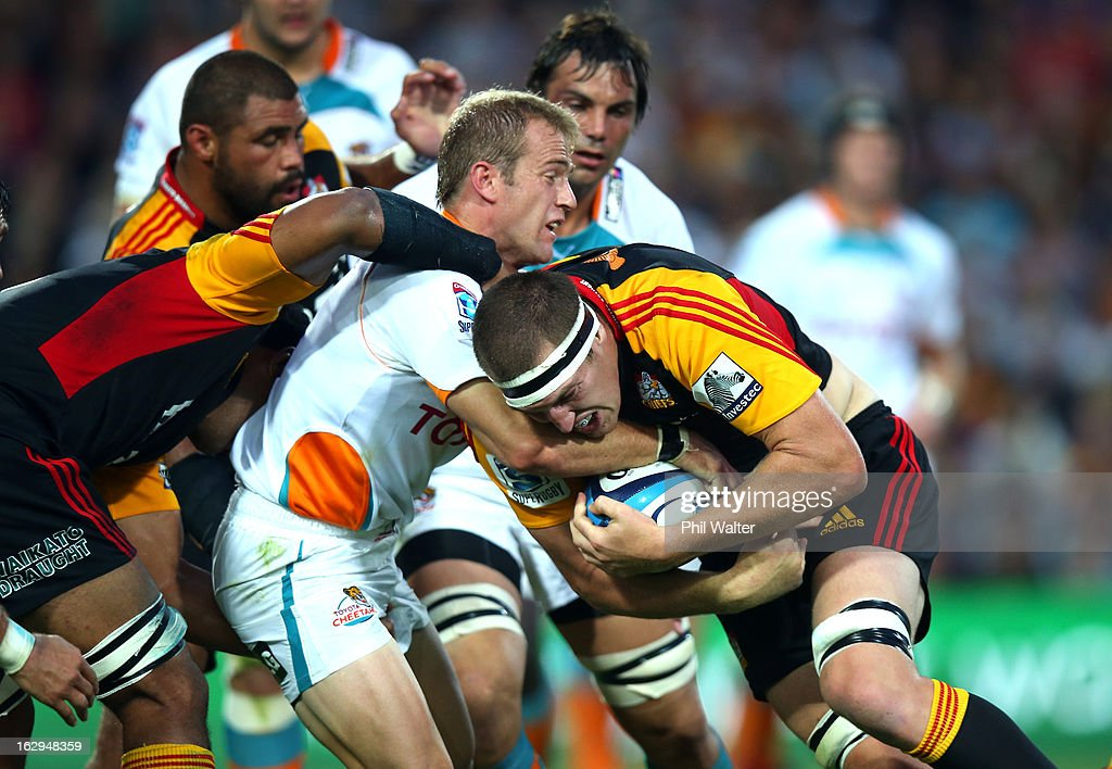 Brodie Retallick of the Chiefs is tackled by Sarel Pretorius of the Cheetahs during the round three Super Rugby match between the Chiefs and the Cheetahs at Waikato Stadium on March 2, 2013 in Hamilton, New Zealand.