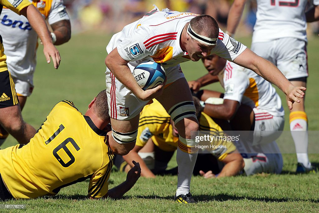 Brodie Retallick of the Chiefs is tackled during the Super Rugby trial match between the Hurricanes and the Chiefs at Mangatainoka RFC on February 16, 2013 in Mangatainoka, New Zealand.