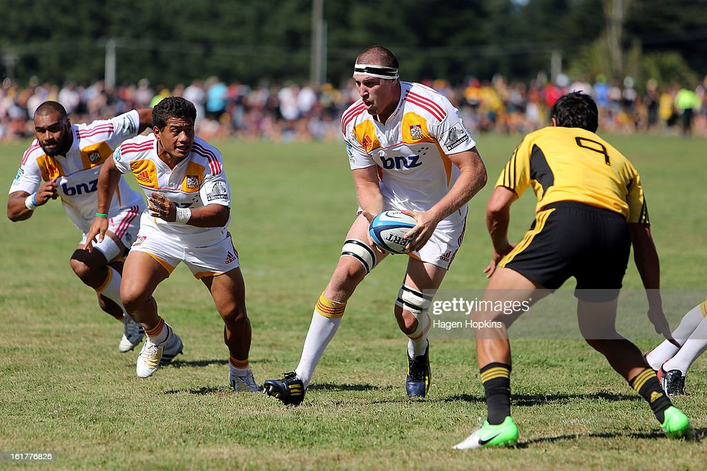 Brodie Retallick of the Chiefs looks to pass to Maritino Nemani during the Super Rugby trial match between the Hurricanes and the Chiefs at Mangatainoka RFC on February 16, 2013 in Mangatainoka, New Zealand.