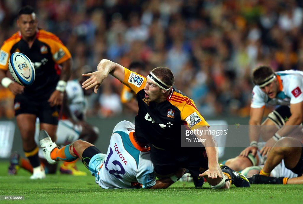 Brodie Retallick of the Chiefs offloads the ball in the tackle of Robert Ebersohn of the Cheetahs during the round three Super Rugby match between the Chiefs and the Cheetahs at Waikato Stadium on March 2, 2013 in Hamilton, New Zealand.