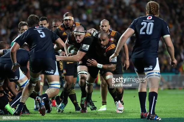 Brodie Retallick of the Chiefs takes the ball up supported by Liam Messam during the round six Super Rugby match between the Chiefs and the Bulls at...