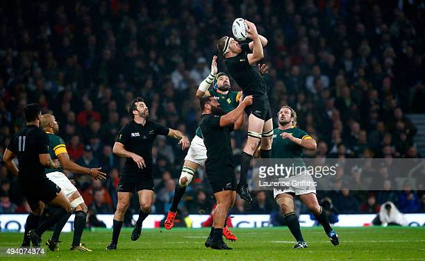 Brodie Retallick of the New Zealand All Blacks catches the ball supported by Charlie Faumuina of the New Zealand All Blacks during the 2015 Rugby...